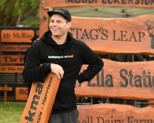 Married at First Sight celebrity Brett Renall works on his stand at the Southern Field Days at...