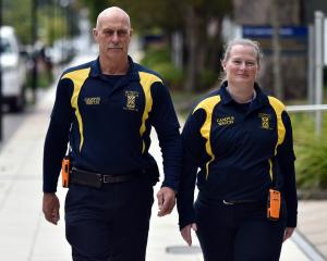 Campus Watch team leader Peter Corbett and team member Janine Neill patrol the university on...