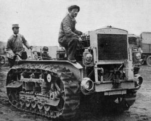 One of the wonders of the war: the caterpillar tractor which goes anywhere and everywhere and...