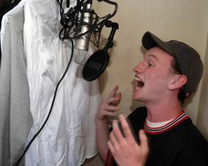 Christian Tucker performs one of his poems in his makeshift recording studio. Photo: Stephen...