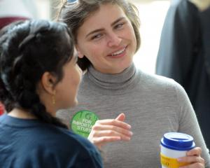 Chloe Swarbrick discusses policy with students at clubs day yesterday. Photos Christine O'Connor