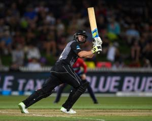 : New Zealand batsman Colin Munro hits a six during the International Twenty20 match between New...
