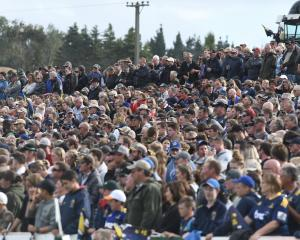 The 7000-strong crowd enjoys the Super Rugby pre-season match between the  Highlanders and the ...