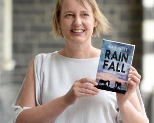 Dunedin author Ella West with her new novel Rain Fall, a teenage murder mystery set in Westport....