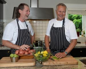 Cameraman Michael Belfast puts British celebrity chefs (from left) Paul Rankin and Nick Nairn in...