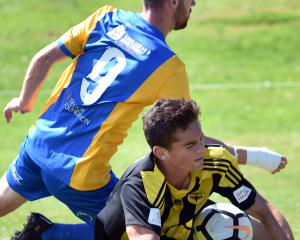 Southern United striker Garbhan Coughlan and Phoenix defender Liam Moore clash at Sunnyvale...