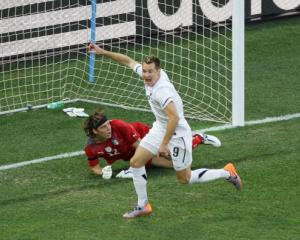 Shane Smeltz celebrates scoring for New Zealand against Italy during the 2010 World Cup in...