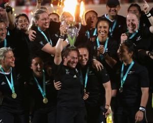 The Black Ferns celebrate with the trophy after their World Cup final win over England. Photo Getty