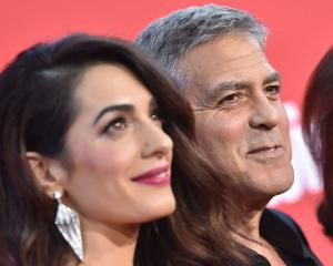 George Clooney and his wife, Amal. Photo: Getty