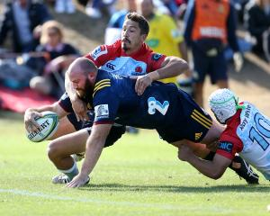 Greg Pleasants-Tate, of the Highlanders, in the clutches of  Jake Gordon, of the Waratahs,  dives...