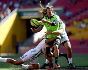 Dan Pryor offloads during the Highlanders' controversial loss to the Chiefs yesterday. Photo:...