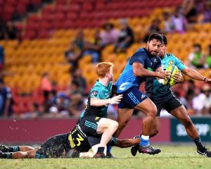 The Blues' George Moala tries to bust through the Hurricanes defence. Photo: Getty