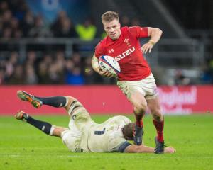Gareth Anscombe runs the ball up for Wales against England. Photo: Getty