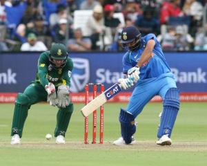 India's Rohit Sharma plays a shot watched by South Africa wicketkeeper Heinrich Klaasen. Photo:...