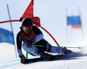 Duncan Campbell, of Queenstown, competes  in the men's snowboard-cross yesterday. Photo: Getty...