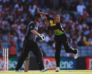 Australia's Ashton Agar (R) proved a handful for the New Zealand batsmen in the T20 tri-series...
