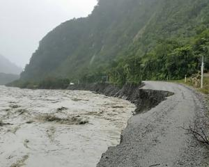 Glacier Road, the access road to Fox Glacier, was washed away during the storm. Photo: Supplied
