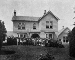 A group of visitors and pupils at the opening of John McGlashan College at Maori Hill, Dunedin. —...