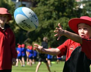 Mornington School pupil Coban Sullings (9) tries his hand at rugby.