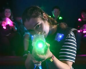 Otago University Laser Tag Society member Michelle Lindsay (19, front) hits her mark with the...
