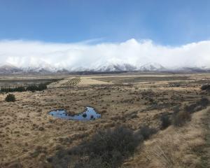 A walk into Baikie Hut from Lake Pukaki presents a dramatic Mackenzie region landscape of snow...