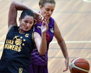 Former Tall Fern and Otago basketball Tracey Kelly (left) tussles with Dot Dixon during a Masters...