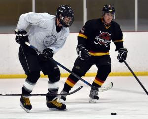 Whitehorse Goldpuckers player Greg Lane controls the puck in a match against Jurassics during a...