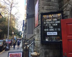 A  #MeToo sign outside the Gustavus Adolphus Church in New York City. Photo: Supplied