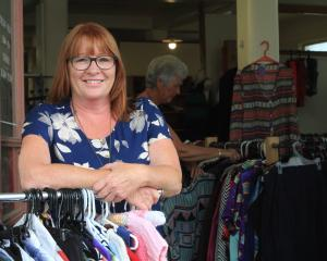 Debbie Shields models clothing from Awamoa Clothing on her last day as owner this month after 29...