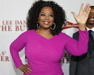 Oprah Winfrey says she regrets the furore over her Swiss handbag experience.  REUTERS/Fred...