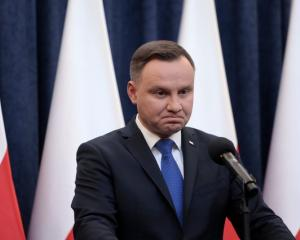 Poland's President Duda speaks during his media announcement about his decision on the Holocaust...