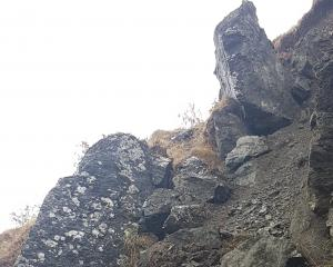 This car-sized boulder is perched precariously above the Crown Range road at the 8.5km mark on...