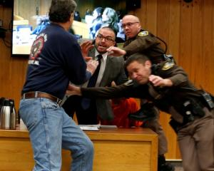 Randall Margraves lunges at Larry Nassar during victim statements of his sentencing in the Eaton...
