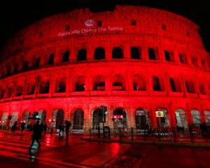 The Colosseum is lit up in red to draw attention to the persecution of Christians around the...