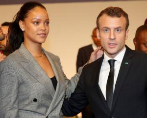 "French President Emmanuel Macron and singer Rihanna attend the ""GPE Financing Conference, an..."