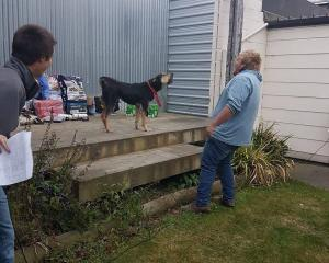 Gus Gibson gets his dog amped up during last year's Mackenzie Young Farmers Bark Up. The...