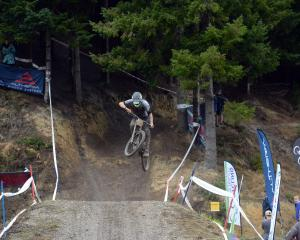 Sam Blenkinsop gets some air over the last jump of the Signal Hill track. Photos: Linda Robertson