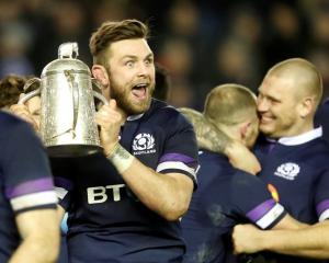 Scotland's Ryan Wilson celebrates with the Calcutta Cup trophy after the match. Photo: Reuters