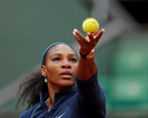 Serena Williams prepares to serve against Magdalena Rybarikova.  Photo Reuters