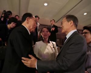 South Korean President Moon Jae-in talks with president of the Presidium of the Supreme People's...