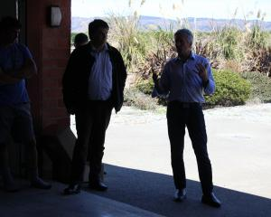 Minister for Agriculture Damien O'Connor (right) talks to farmers about Mycoplasma bovis at Lyall...