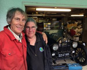 Retired couple Dirk and Trudy Regter take a break from repairing their 1915 Ford Model T in...