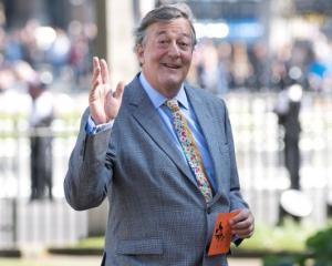 Actor Stephen Fry at Westminster Abbey in London. Photo: Reuters