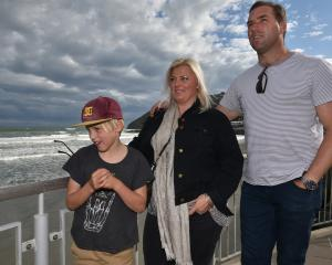 Will (9), Kristie and Tom Macaulay at one of their favourite Dunedin hangouts, St Clair Esplanade...
