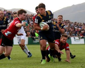 Tei Walden carries the ball for the Highlanders against the Crusaders in last week's final Super...