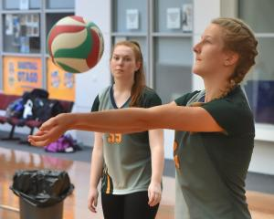 Eva Hoffmans digs the ball in a volleyball game for Bayfield High School at the Edgar Centre...