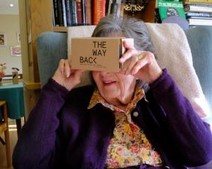 Padfield tries out a specialist VR headset at the Langham Court Dementia Home in Hindhead. Photo:...