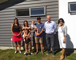 Outside one of the housing trust  homes at Riverside are  from (left) trust  executive officer...