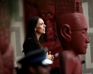 New Zealand Prime Minister Jacinda Ardern speaks on the veranda of Te Whare Runanga on the...