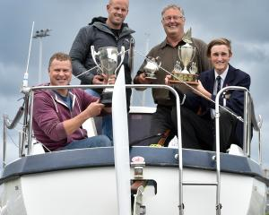 On board Simba are crew members (from left) Phil Heseltine, Aaron Hawkins, Greg Densem and Jack...
